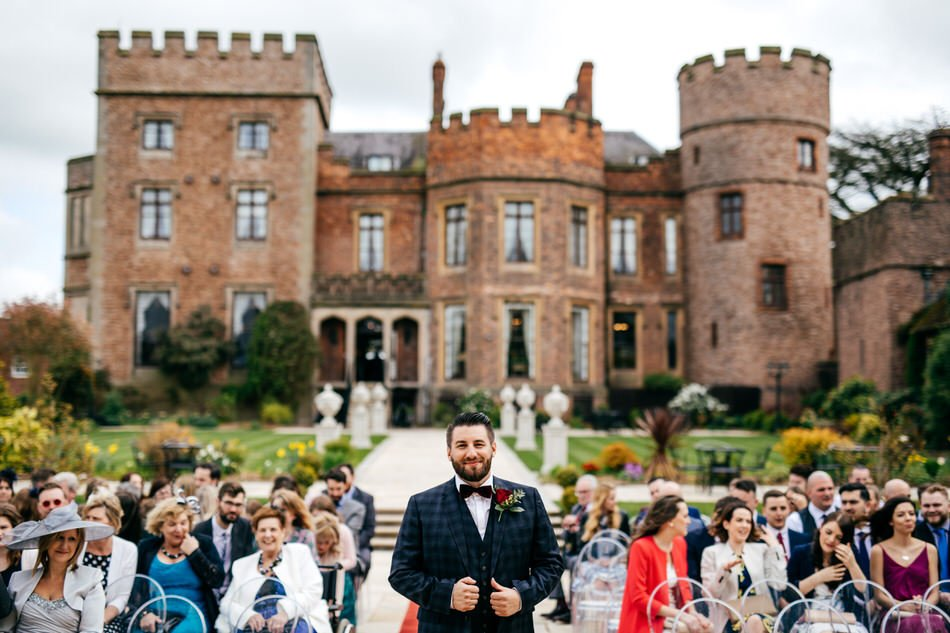 Groom waiting to get married outside of Rowton Castle Wedding