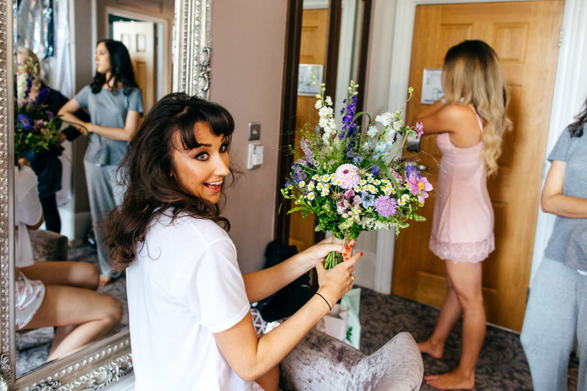 Bride receives wedding flowers surprised face Floral Forae