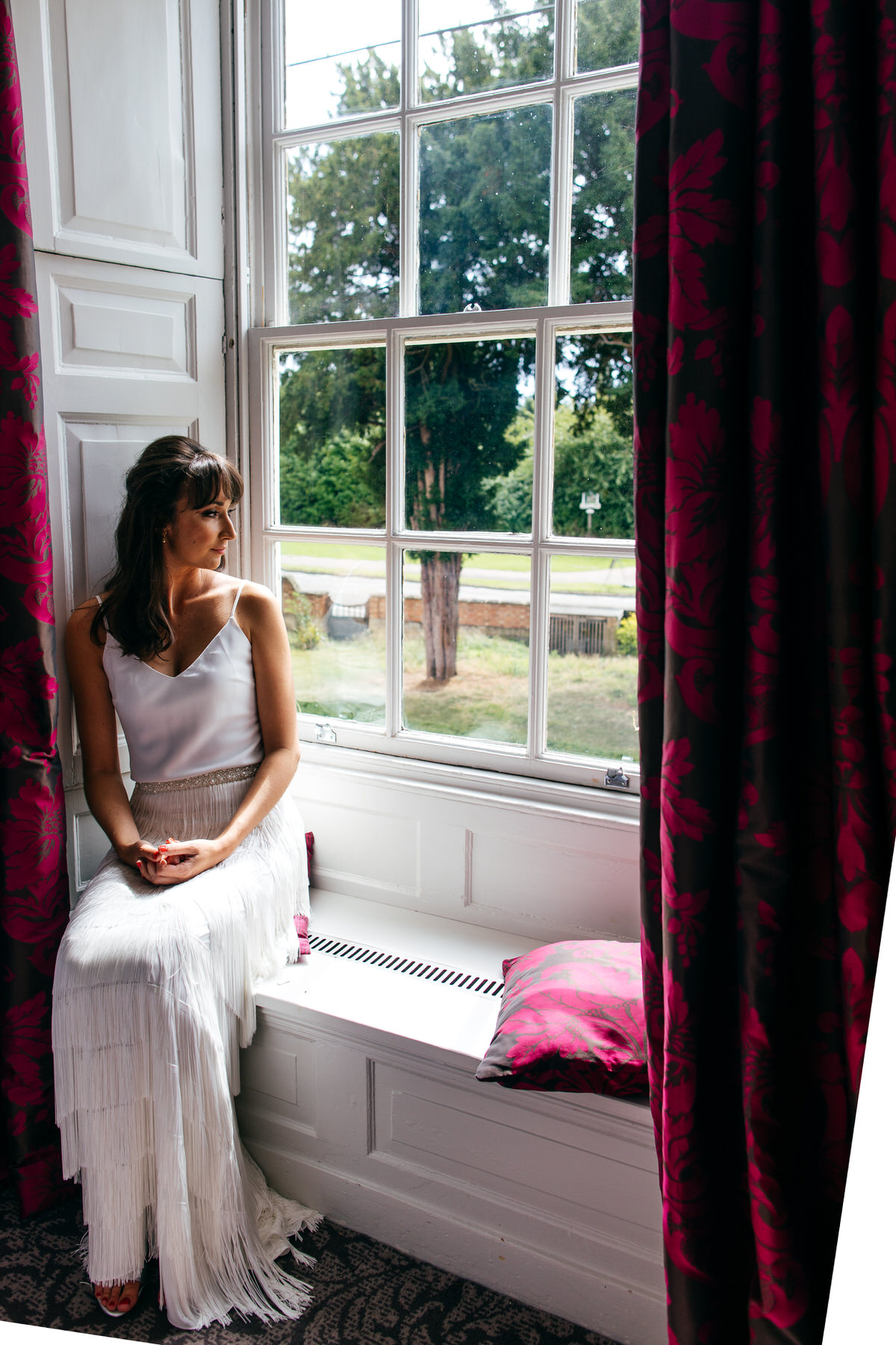 Bridal portrait bride sat in window at Barton Hall near Kettering