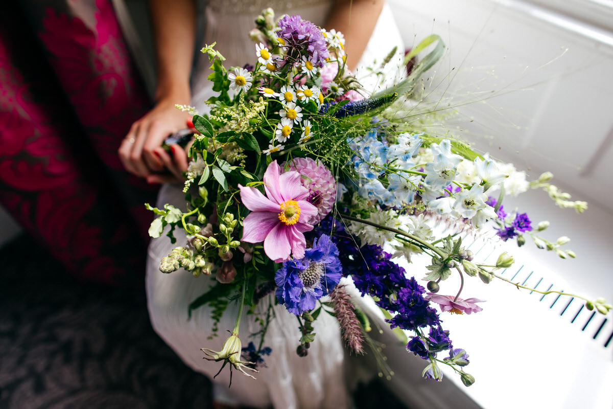 Beautiful bridal bouquet wild flowers asymmetric shape by floral forae northants florist