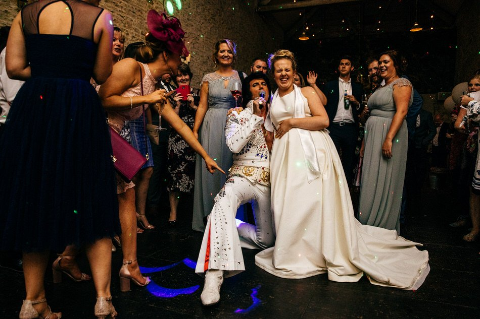 Bride sat on Elvis' lap at Merriscourt Wedding Party