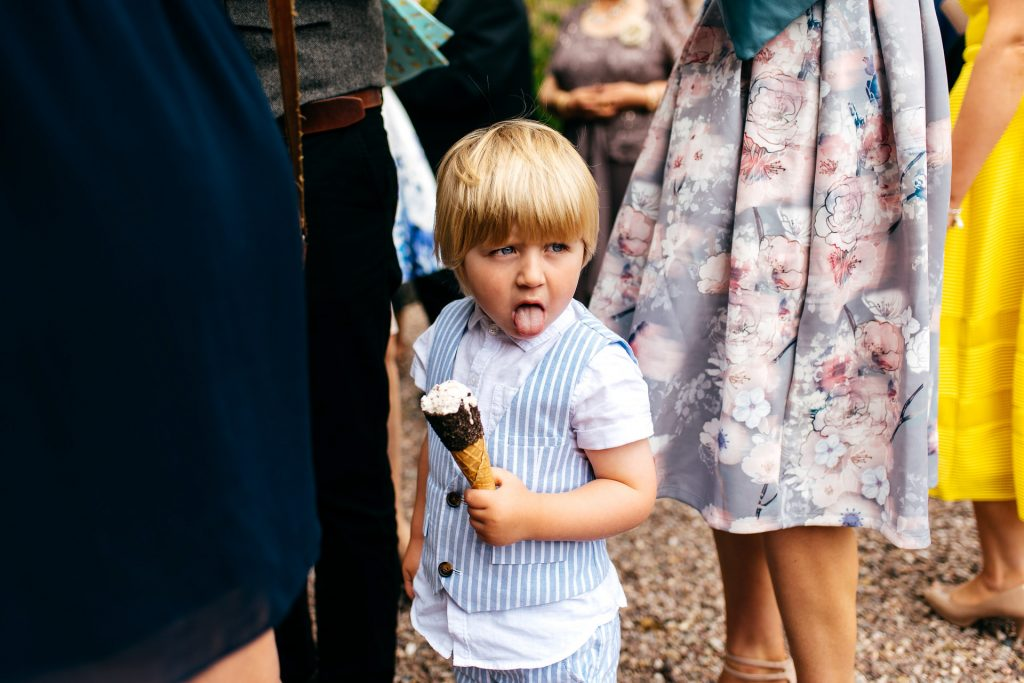 kid with tongue hanging out with an ice cream in hand on really hot summers day