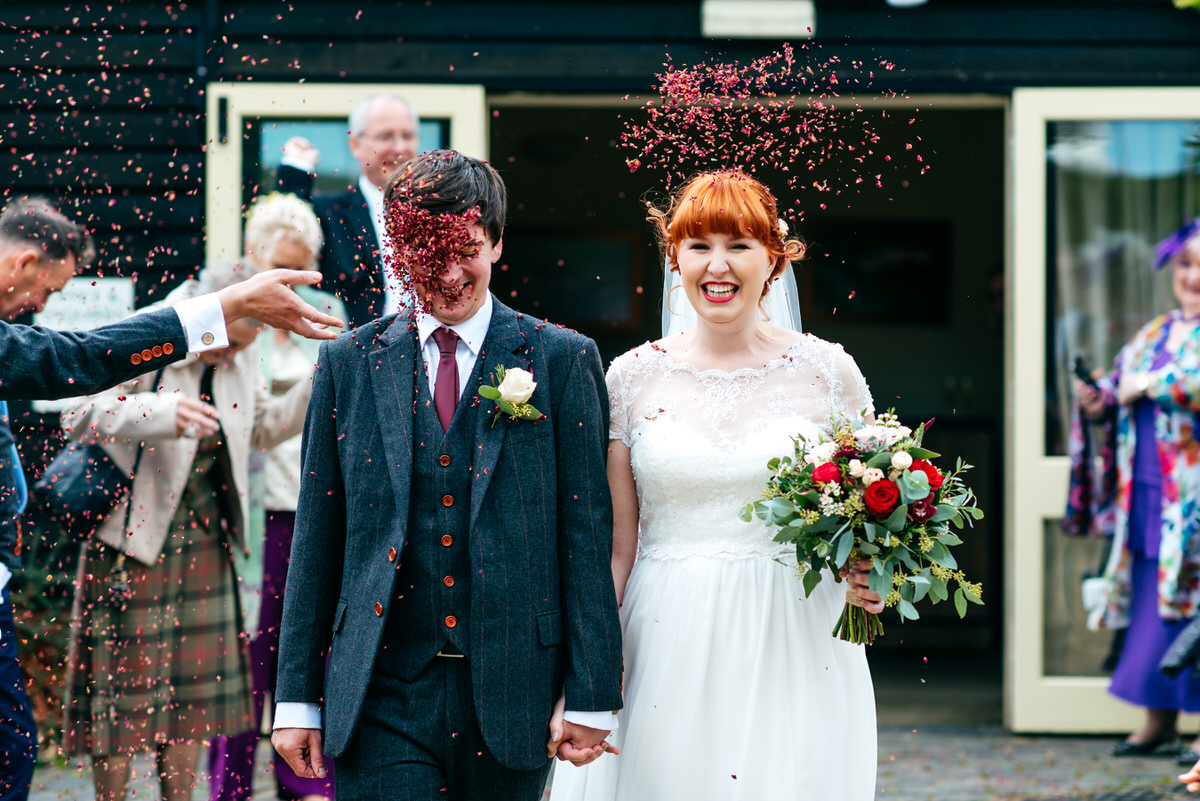Confetti throw in grooms face at South Farm Wedding Funny