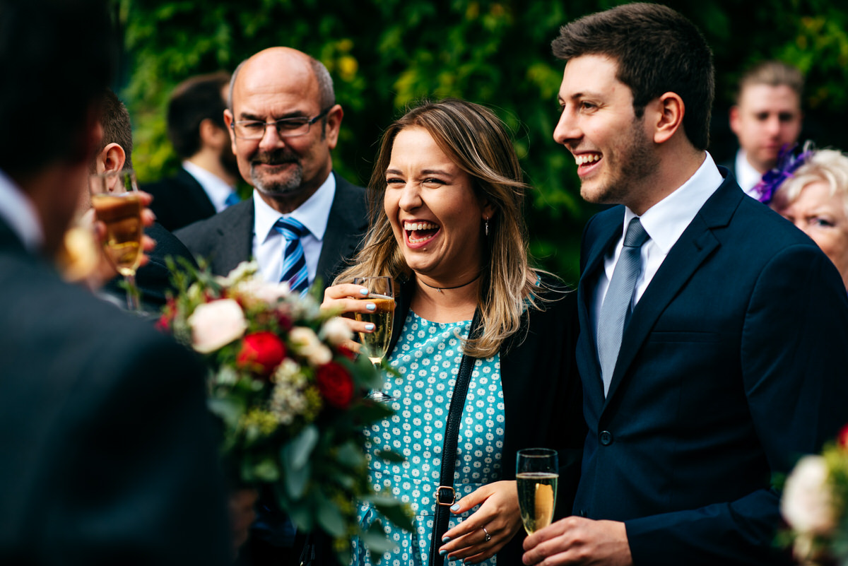 girl enjoying champagne at South Farm Wedding Reception form London Wedding Photographer Jordanna Marston