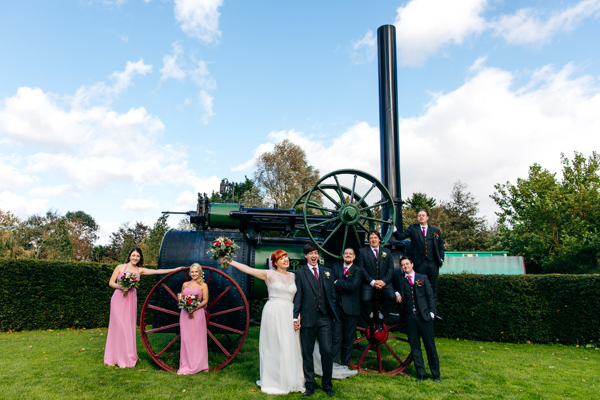 wedding party standing in fron t of tractor ast South Farm Wedding