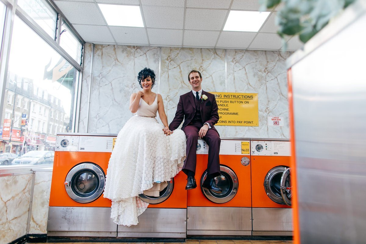 Bride and Groom in launderette next door to Bush Hall Wedding Venue