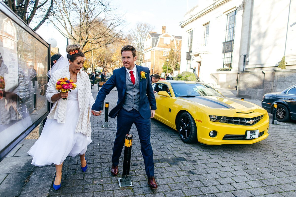 Funny photo of groom narrowing missing bollard Islington Metalworks Wedding