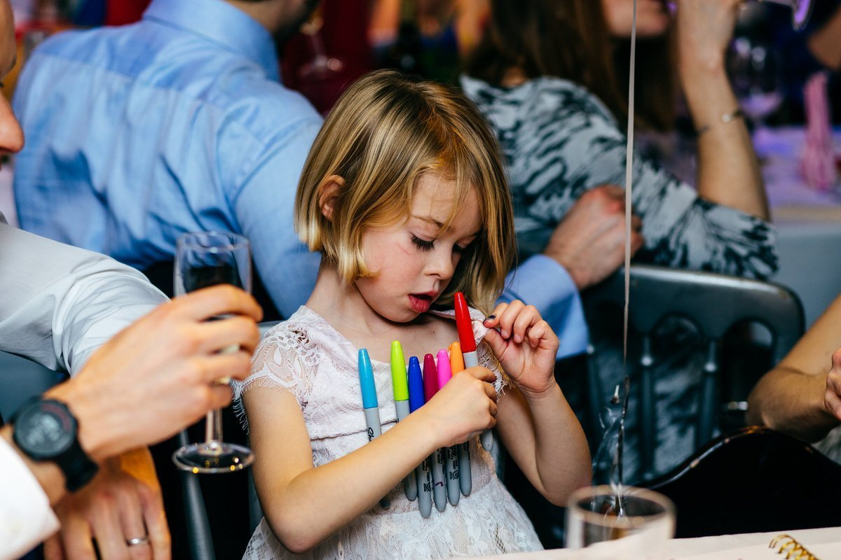 Child clips Sharpies to her dress at Islington Metalworks wedding