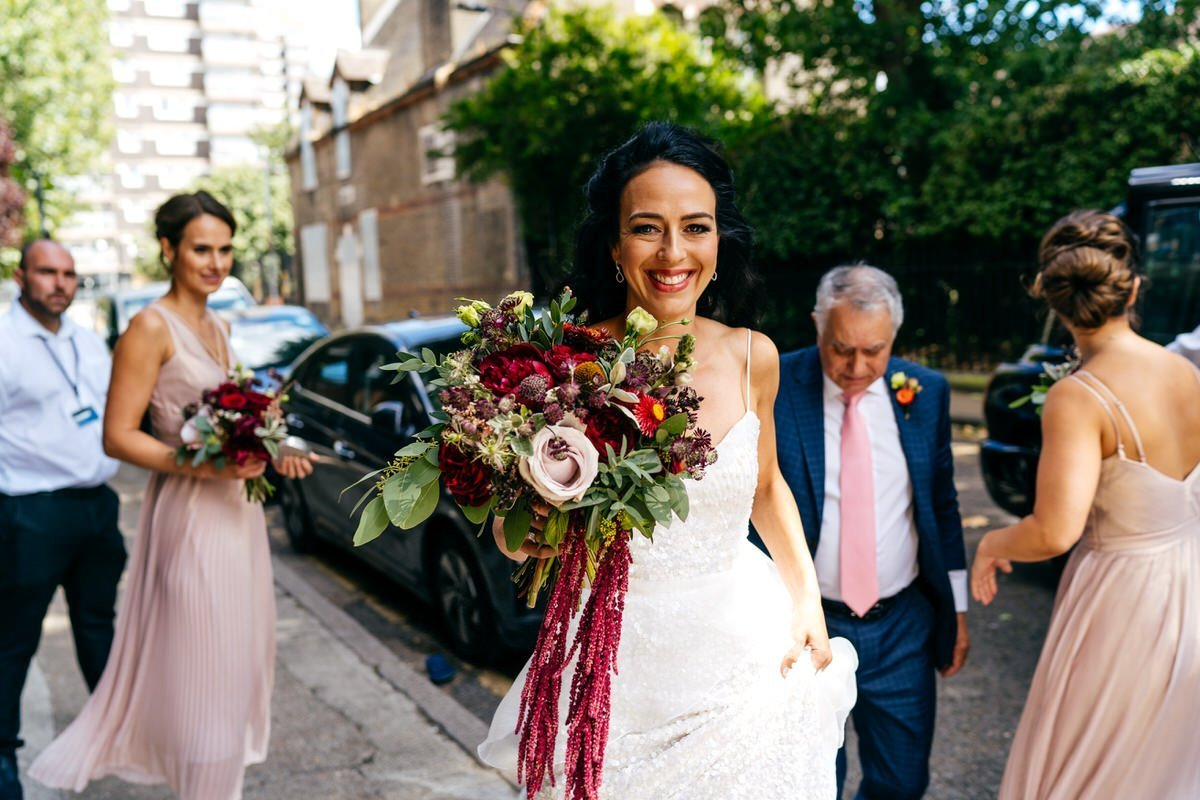Bride arrives with her bridal party outside Wilton's Music Hall