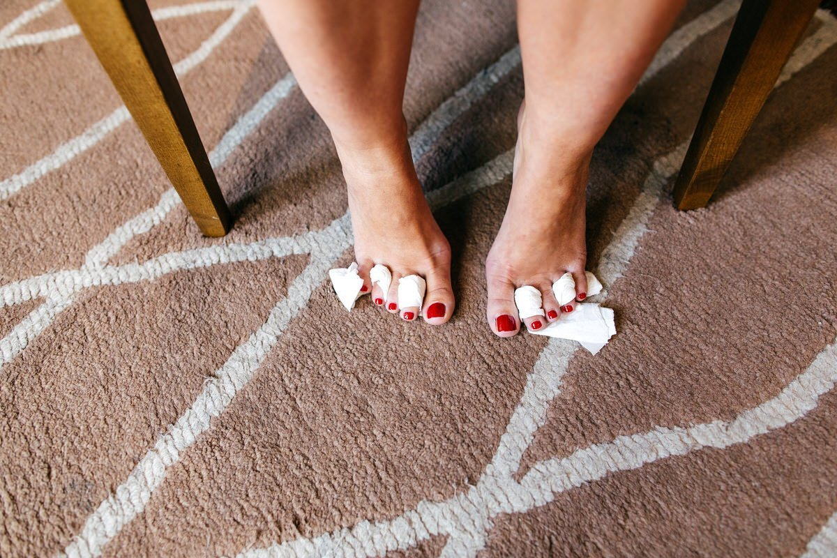 Bride's toes getting painted morning of her wedding at Great John Street Hotel Wedding