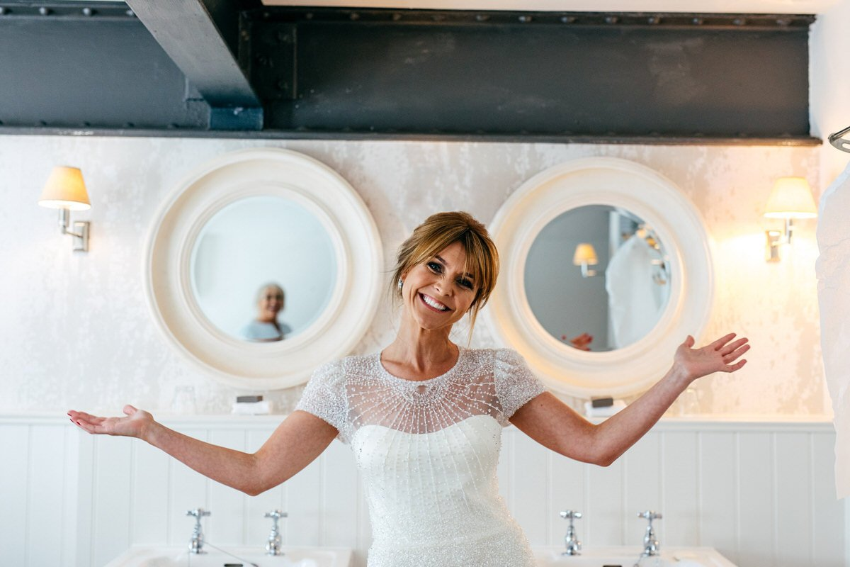 Super smilely bride ready for her Great John Street Hotel Wedding wearing Jenny Packham