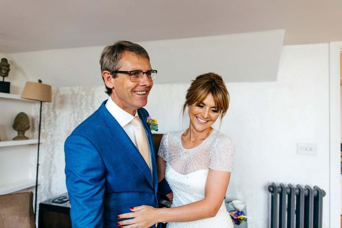 Bride meets dad at hotel in Manchester prior to her wedding
