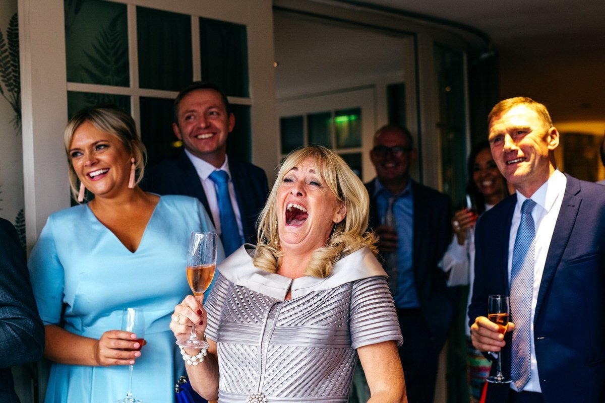Mother of groom laughing her head off