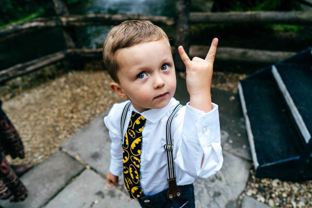 Boy in Batman tie being fierce. Cute candid portrait