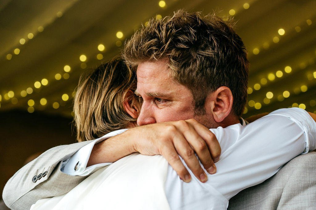 Emotional hug between two friends at Axnoller Wedding