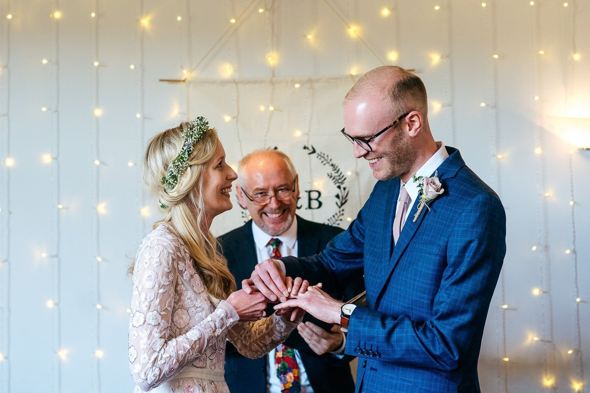 Bride and groom can't get their rings on because it was so hot at Chilli Barn Wedding