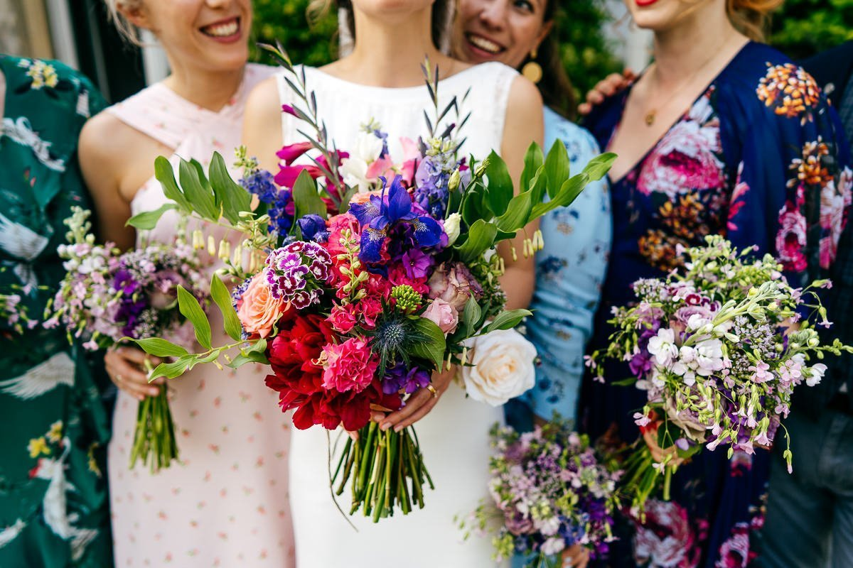Gorgeous colourful flowers at festival wedding at Sparkford Hall