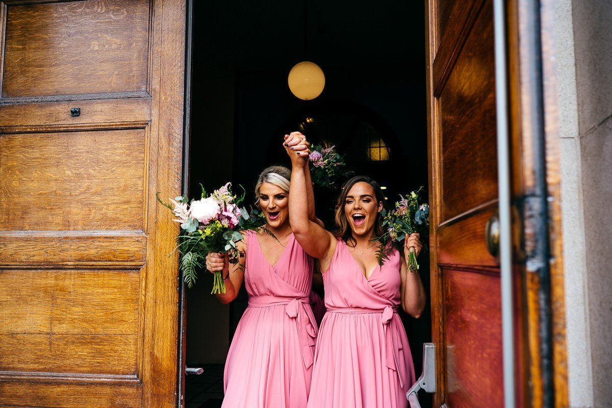 Bridesmaids celebrate marriage as they leave church in Manchester