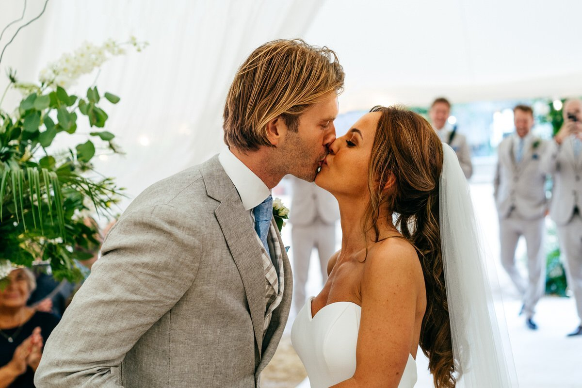 First kiss at Axnoller Wedding in Marquee