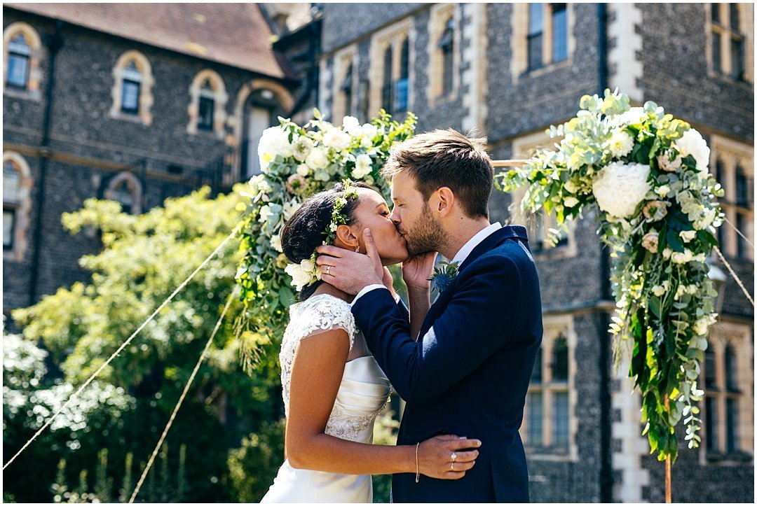 First kiss at Brighton College Wedding outdoor ceremony