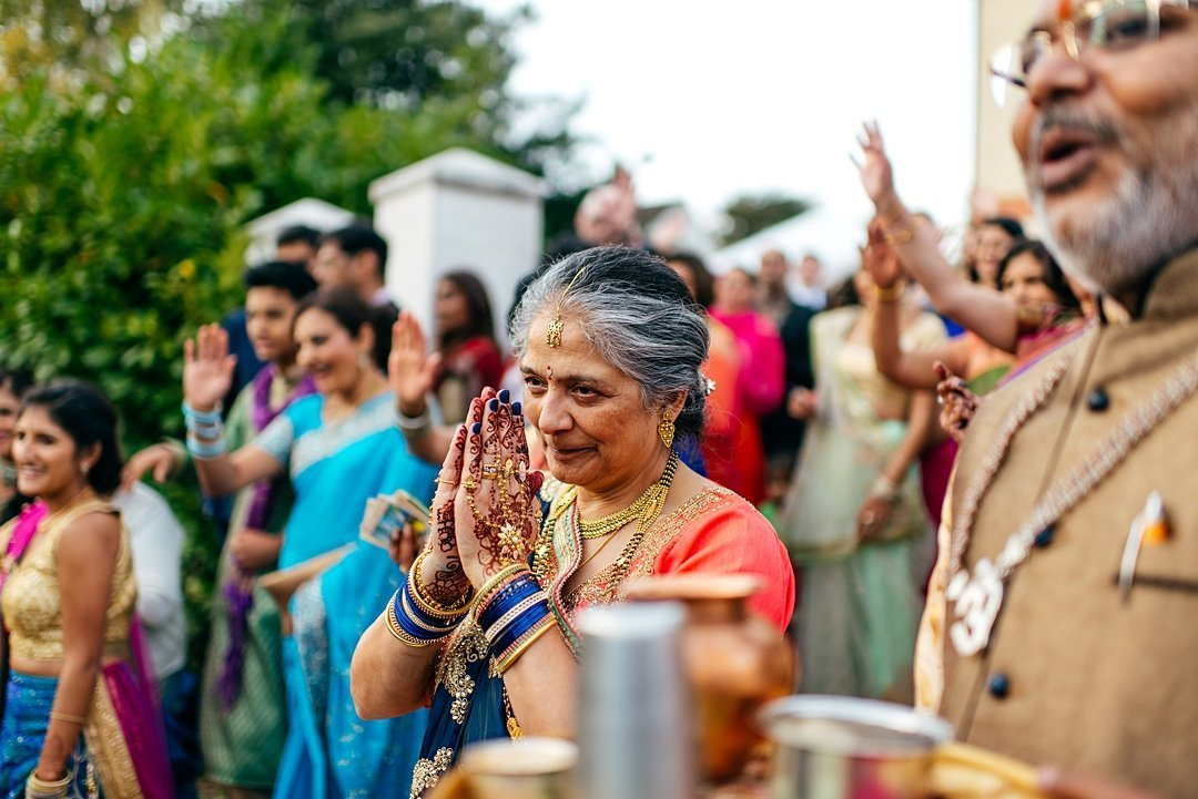 Colourful Indian Wedding coverage mum of bride sends blessing as couple exit