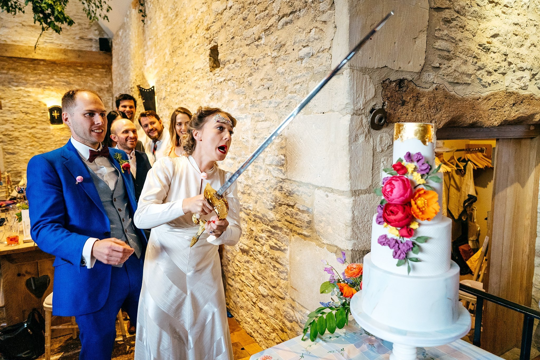 Sleaigh the cake cake cut at Oxleaze Barn Wedding