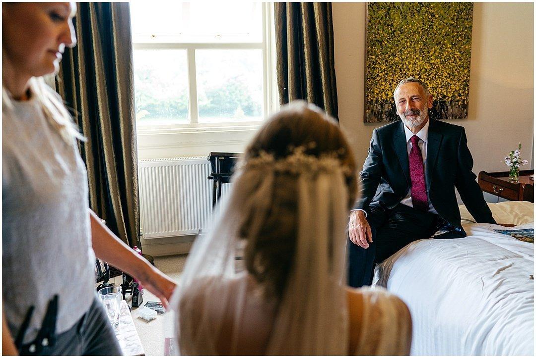 Dada gazes adoringly at bride at Sparkford Hall Wedding