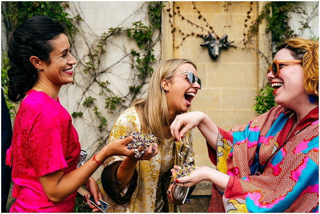 Colourful wedding guests at festival wedding at Sparkford Hall