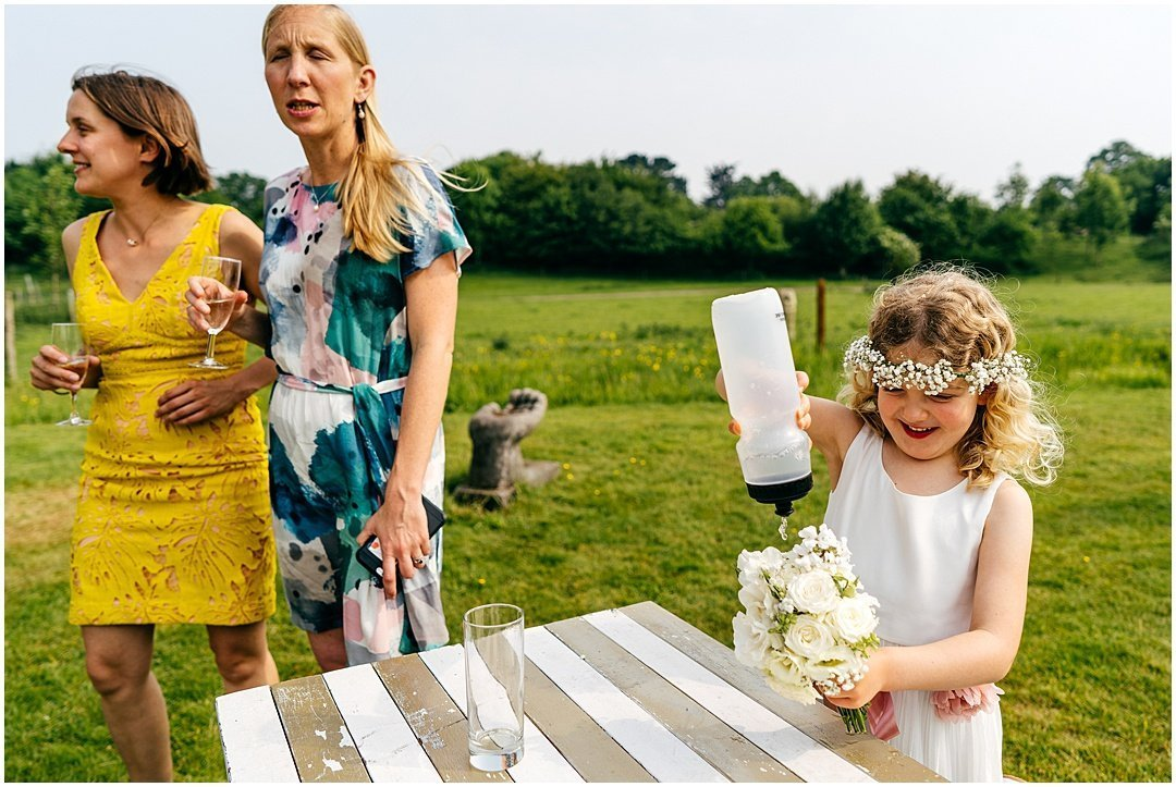 Flowergirl waters her bouquet at Sparkford Hall Wedding with her own water bottle