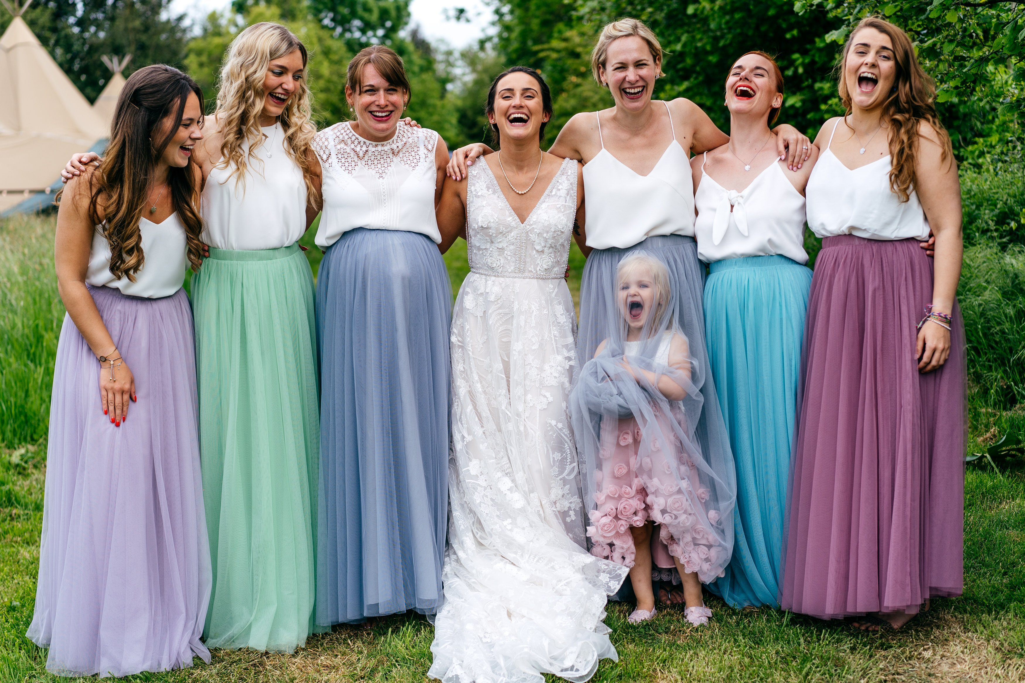 Colourful bridesmaid dresses at wedding at Escheat Farm in Bedfordshire