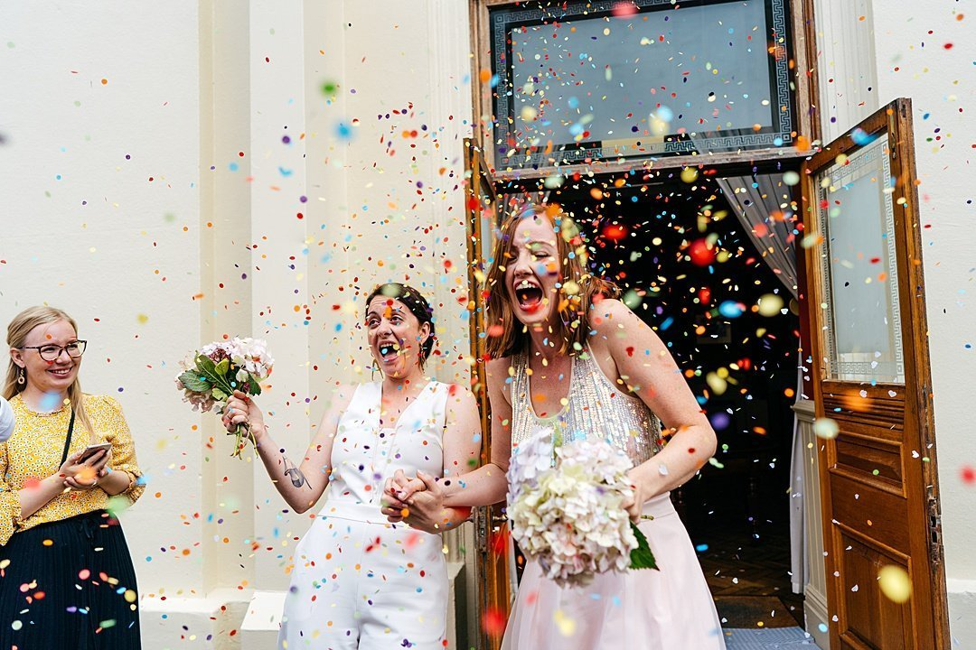 Brighton Town Hall Wedding Confetti Moment as same sex wedding couple are newly married