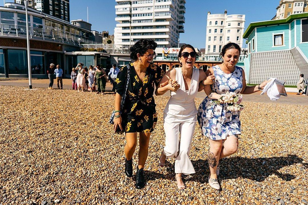 Bride struggles across pebbled Brighton Beach in heels