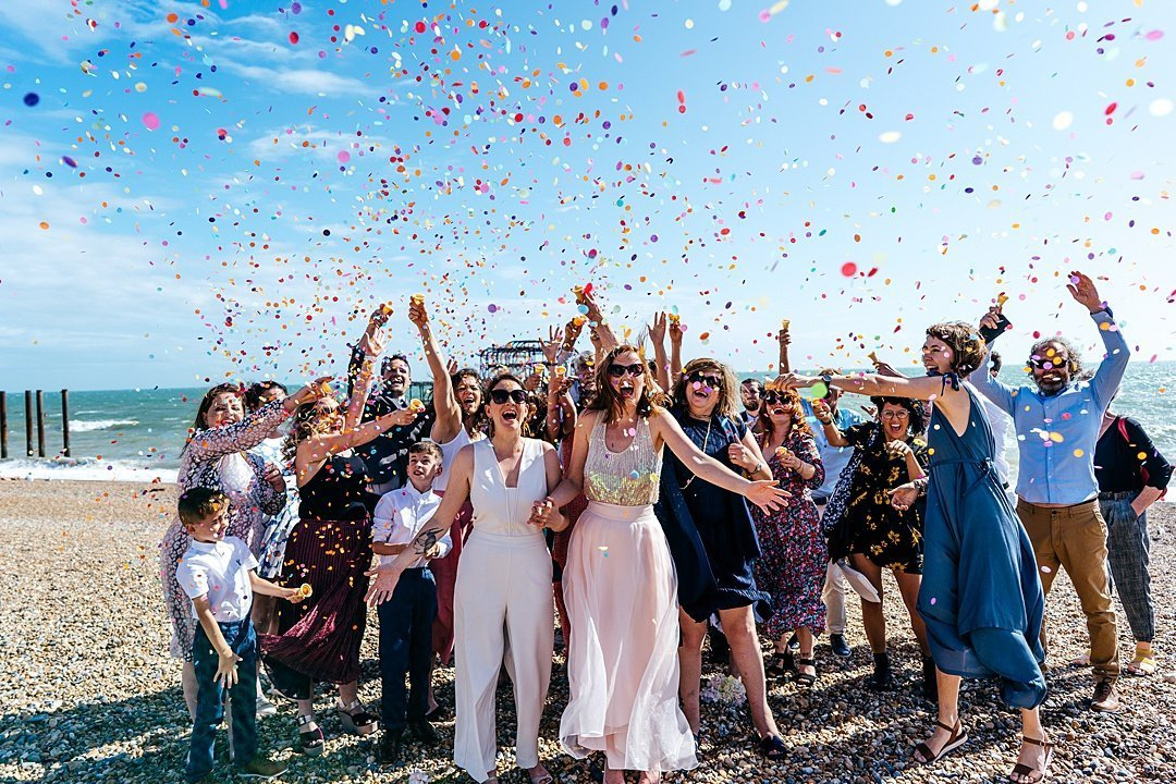 Confetti explosion on Brighton Beach - happy and energetic group photo