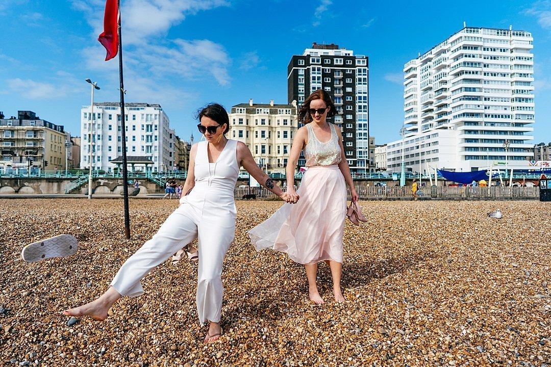 Bride ditches her flip flop at Brighton Beach Wedding. British Seaside scenes