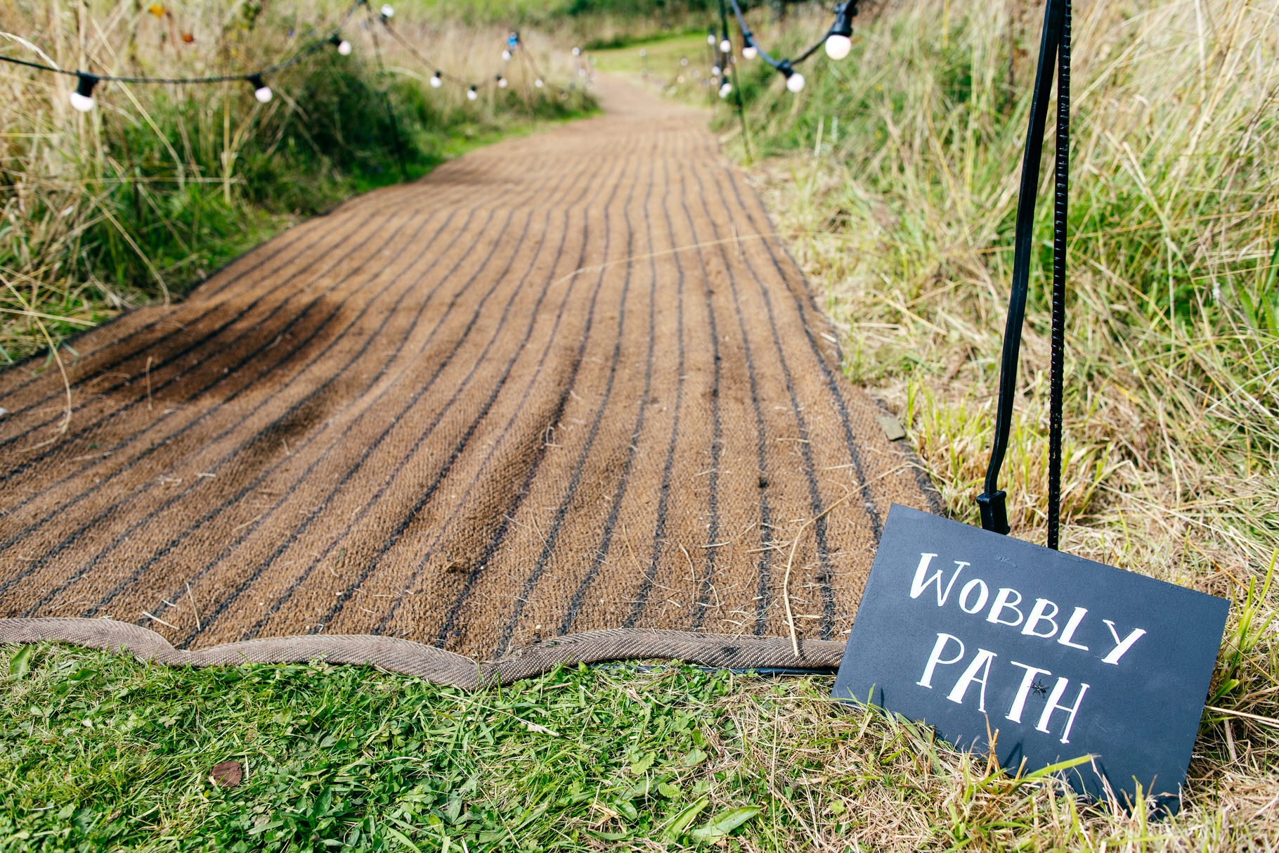 wobbly path with festoon lighting at back garden wedding