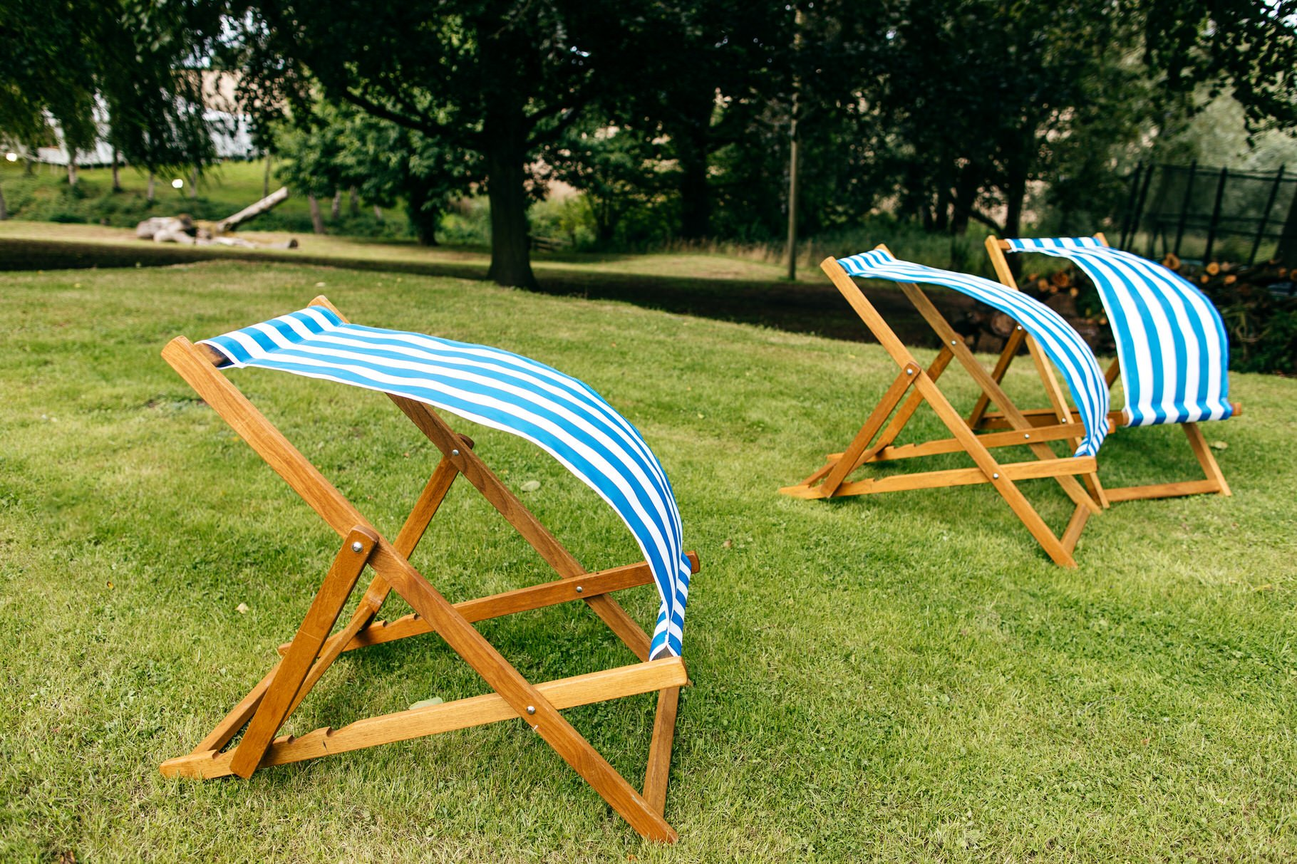 deckchairs blowing in the wind at wedding at home in Herefordshire