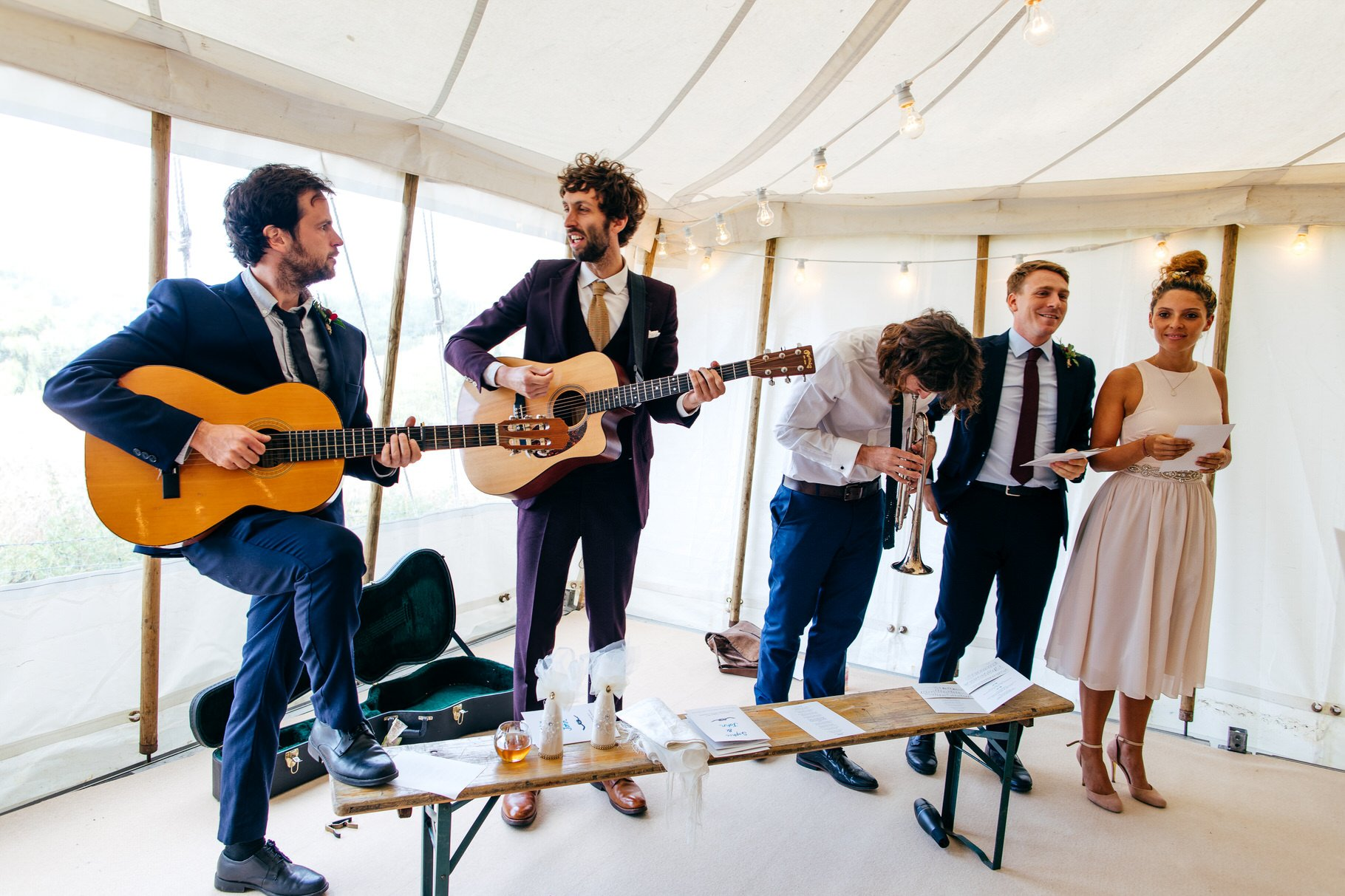 Musicians get ready to play their instruments in wedding tent