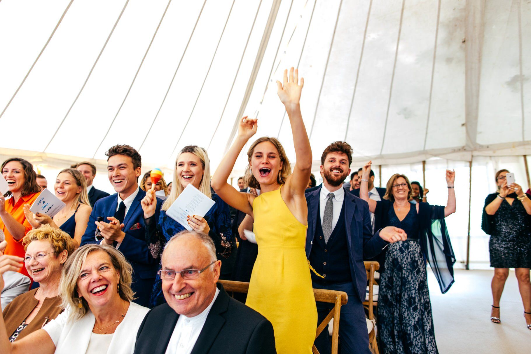 Much dancing and hilarity of wedding guests during wedding ceremony at home