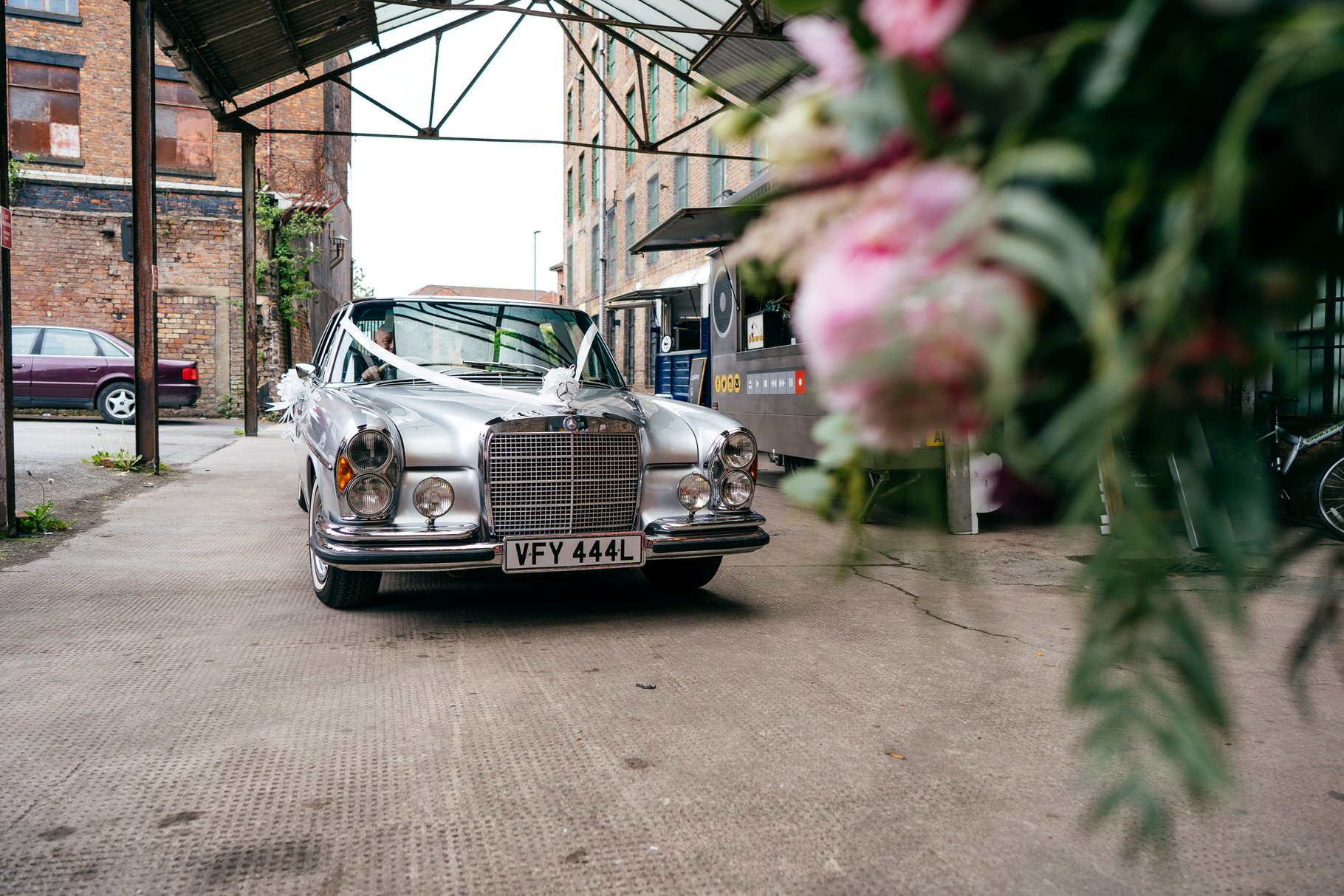 Bride arrives in Rolls Royce car to Hope Mill Theatre Wedding