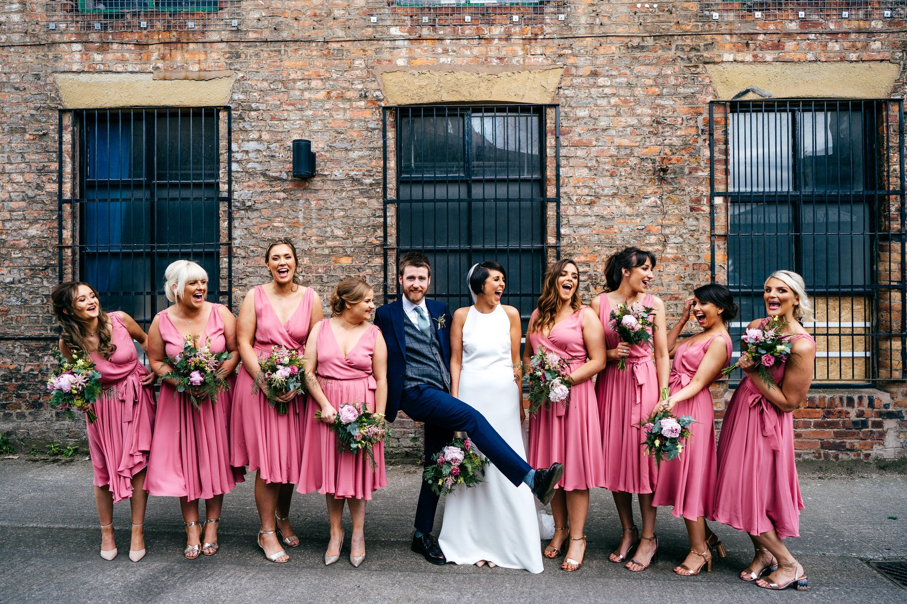 Bride tribe group shot outside Hope Mill Theatre Wedding Venue