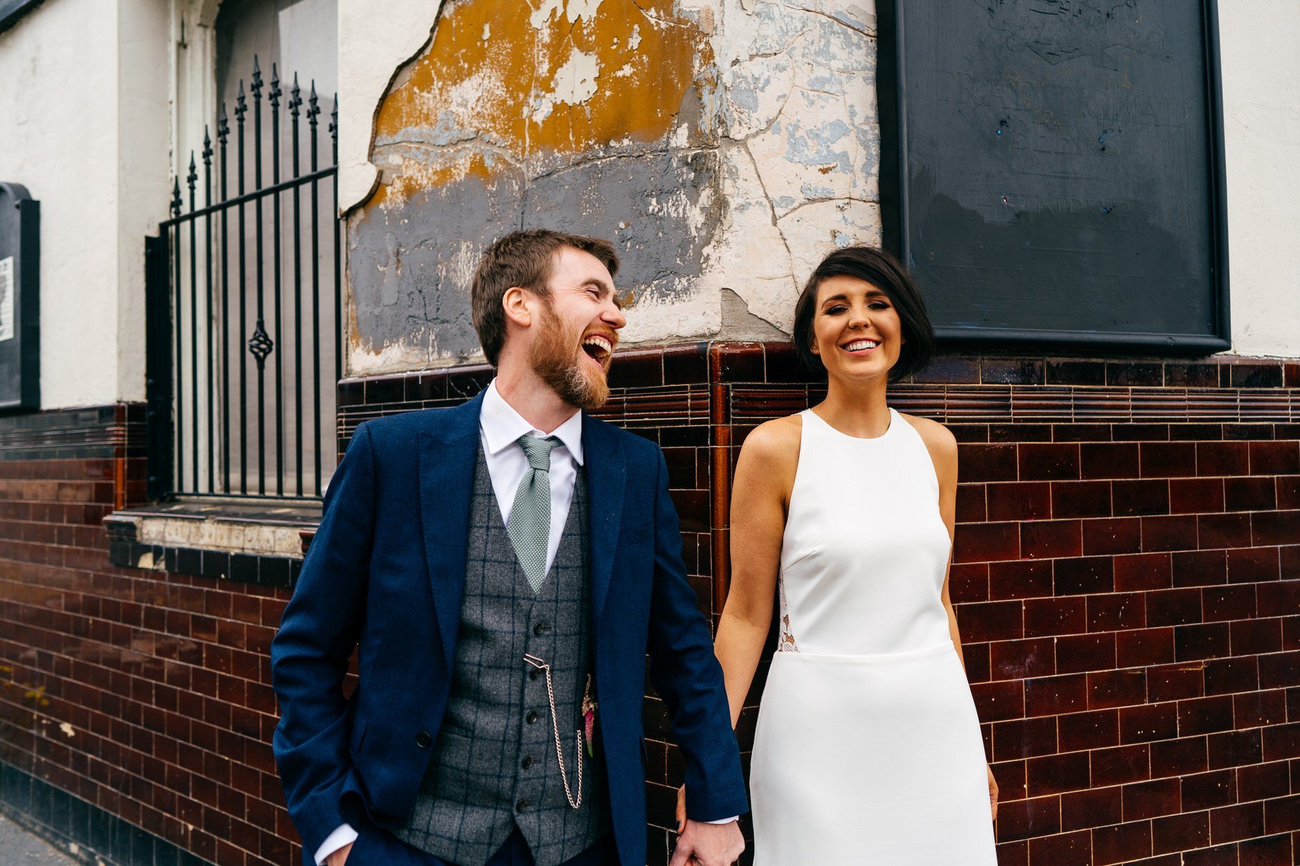 Super fun Hope Mill Theatre Wedding portrait of bride and groom