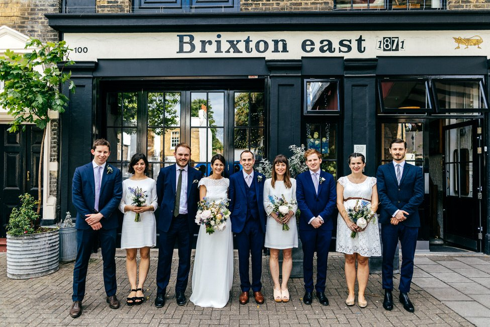 Bridal party line up outside Brixton East now 100 Barrington in Brixton