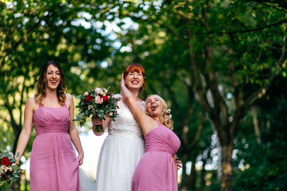 Bride and Bridesmaids at South Farm pose for funny family group shot photo