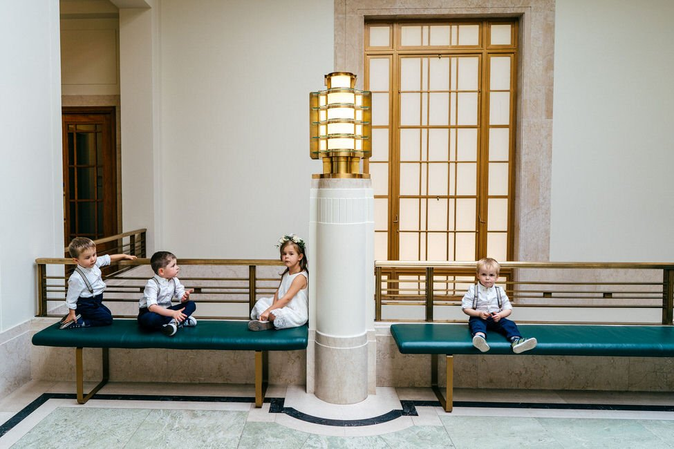 Kids casually wait outside ceremony room at Hackney Town Hall Wedding