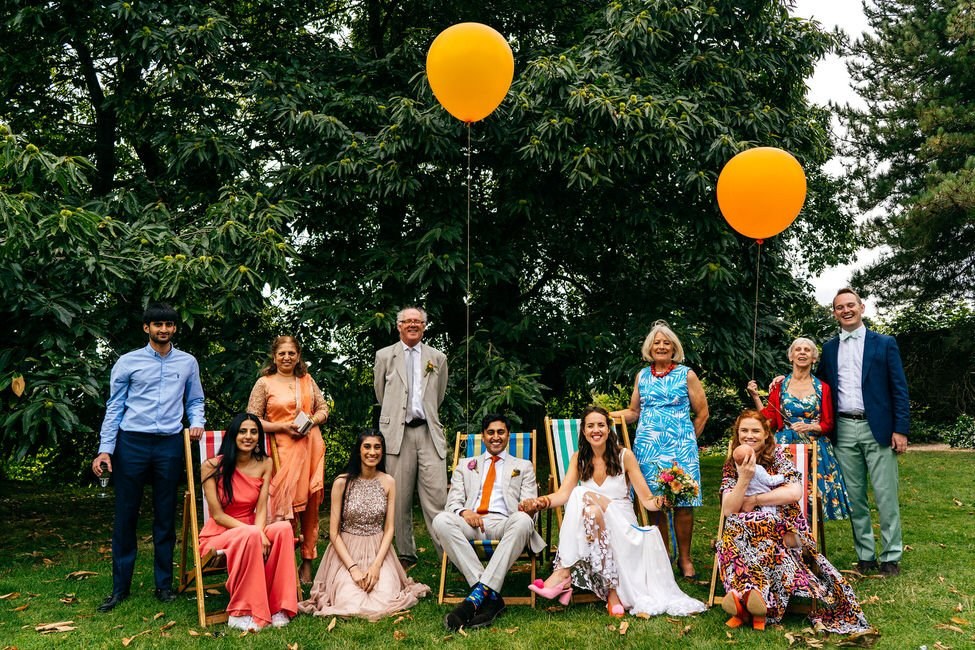 Fun family group shot with deckchairs and big balloons at Hestercombe Gardens Wedding