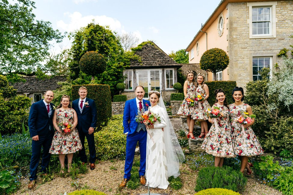 Bridal party in vintage dresses at Oxleaze Barn Cotswolds Wedding