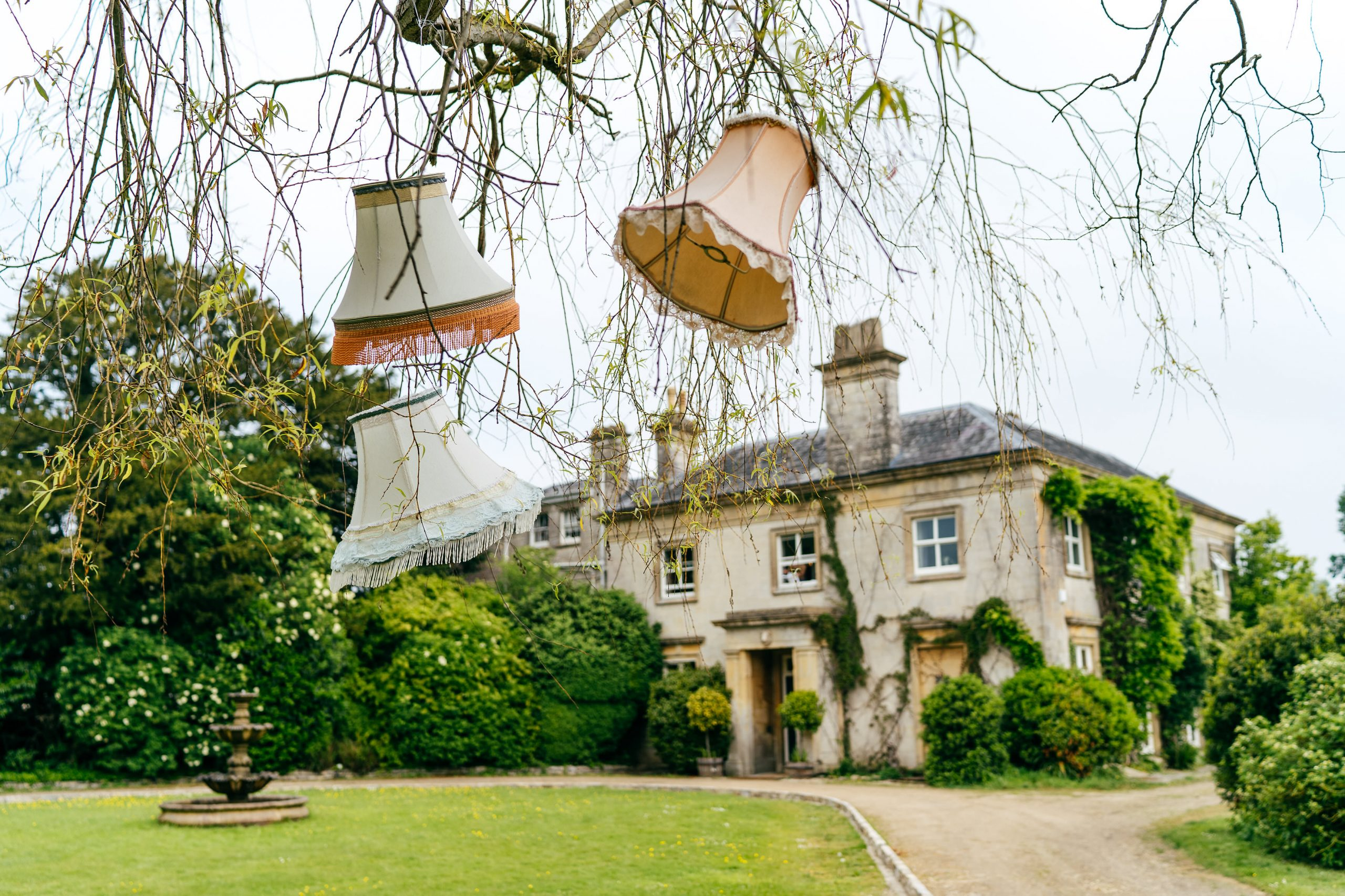Brilliant and Bonkers Sparkford Hall Wedding venue available for private hire all week. Lampshades hang surreally from trees