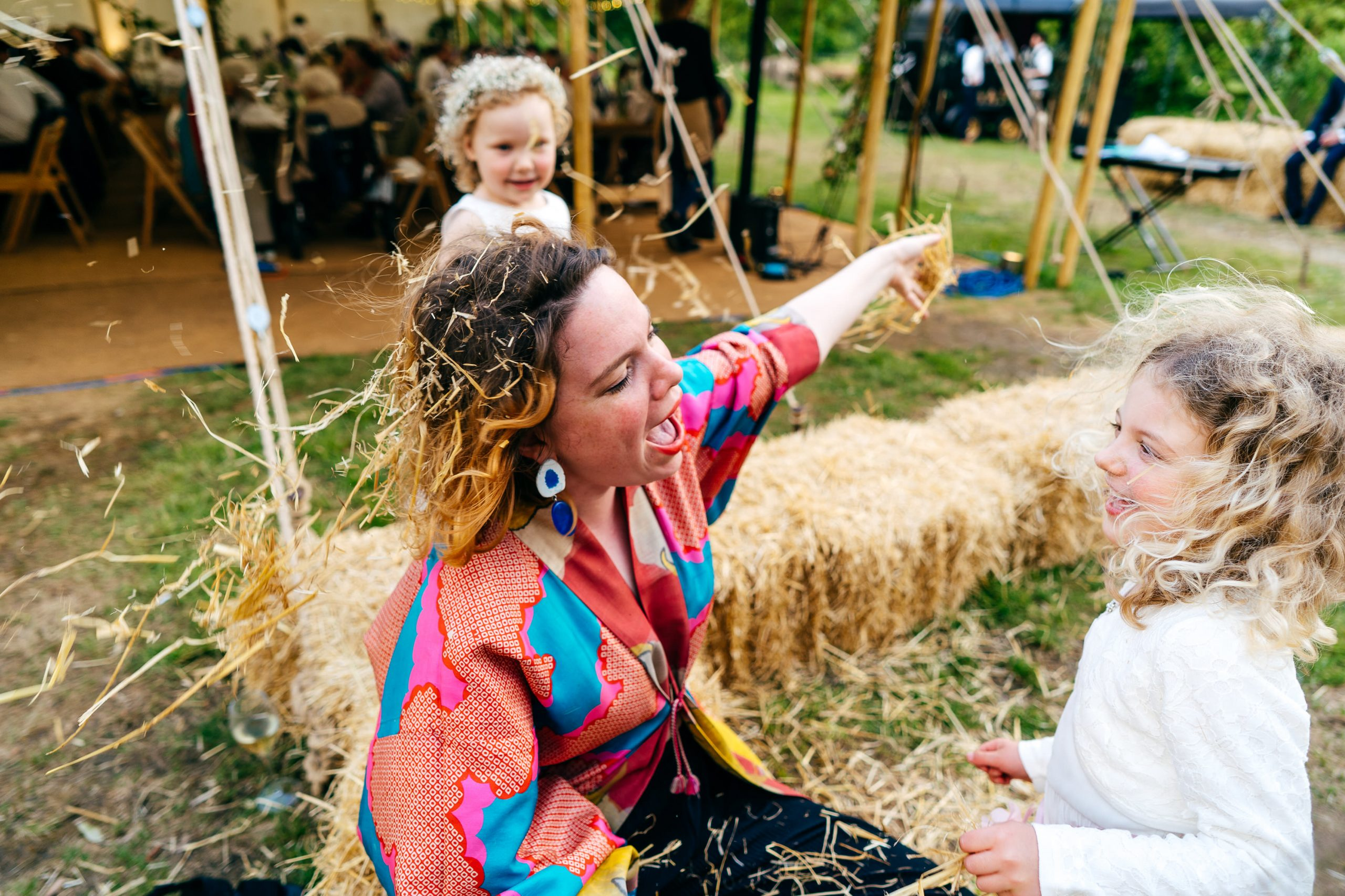 Drunk wedding guest entertains children by letting them put hay in her hair at Sparkford Hall Wedding